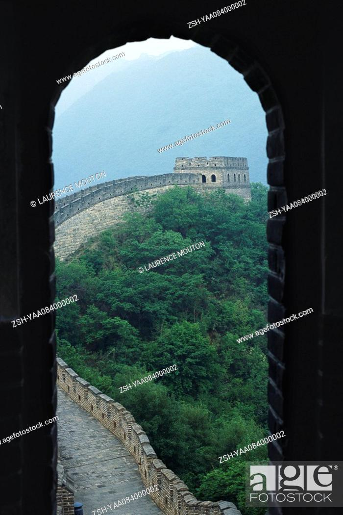 Stock Photo: Great Wall of China, seen through arch.