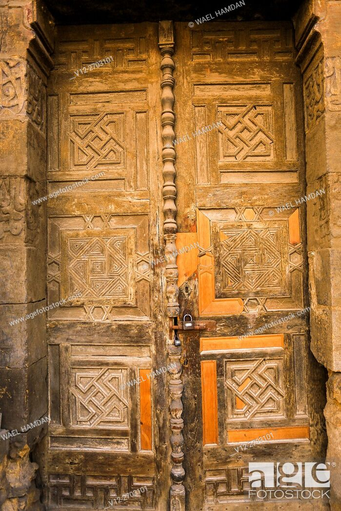 Stock Photo: Wooden door of Bab Tekiah and dome of El- Kolchani Mosque, Dar El-Ahmar City of Cairo, Egypt.