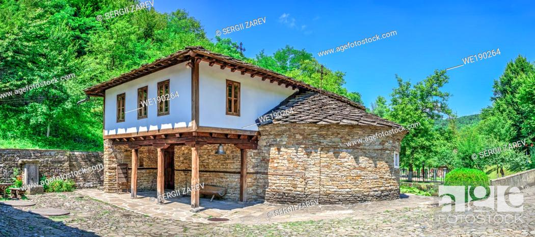 Stock Photo: Epiphany Church with a school in the Etar Architectural Ethnographic Complex in Bulgaria on a sunny summer day. Big size panoramic photo.