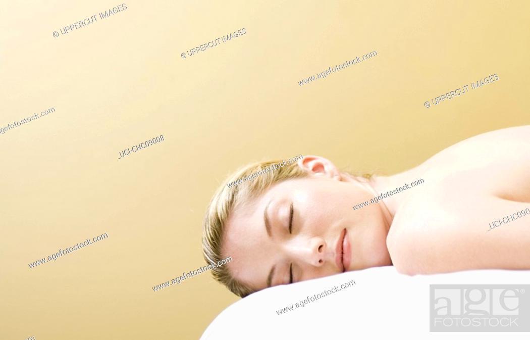 Stock Photo: Woman laying on massage table.