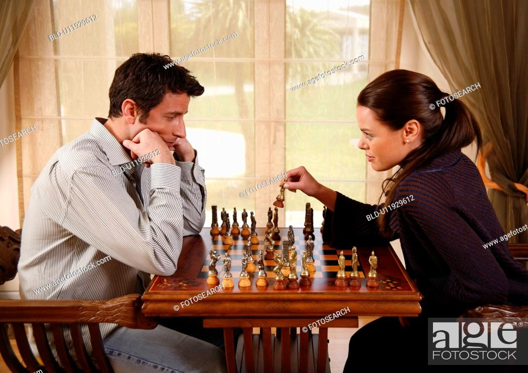 Stock Photo: A man and woman playing chess.