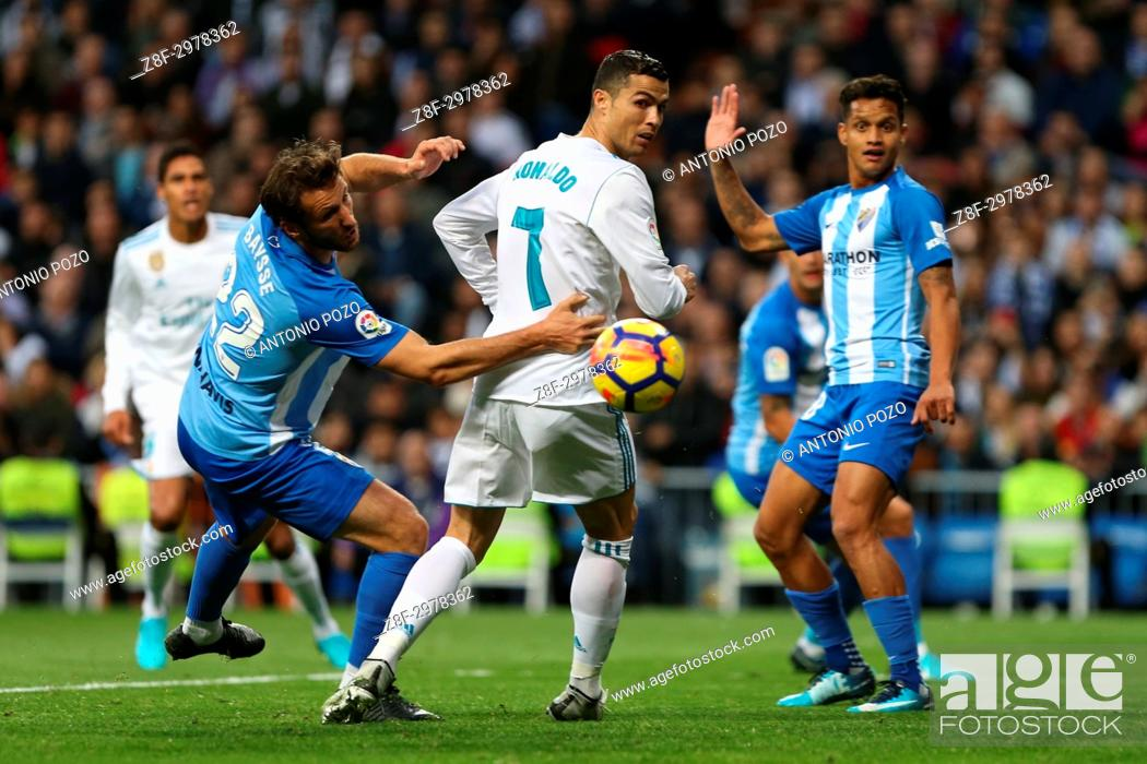 Stock Photo: MADRID, SPAIN. November 25, 2017 - Cristiano Ronaldo and Paul Baysse looking for the ball. Real Madrid have chalked up an important victory, 3-2.