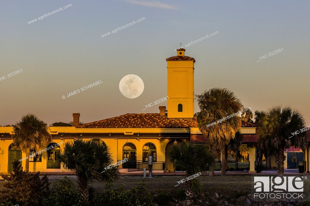 Stock Photo: Moon coming up over historic Venice Seaboard Air Line Railway Station also known as the Venice Train Depot in Venice, Florida, United States.
