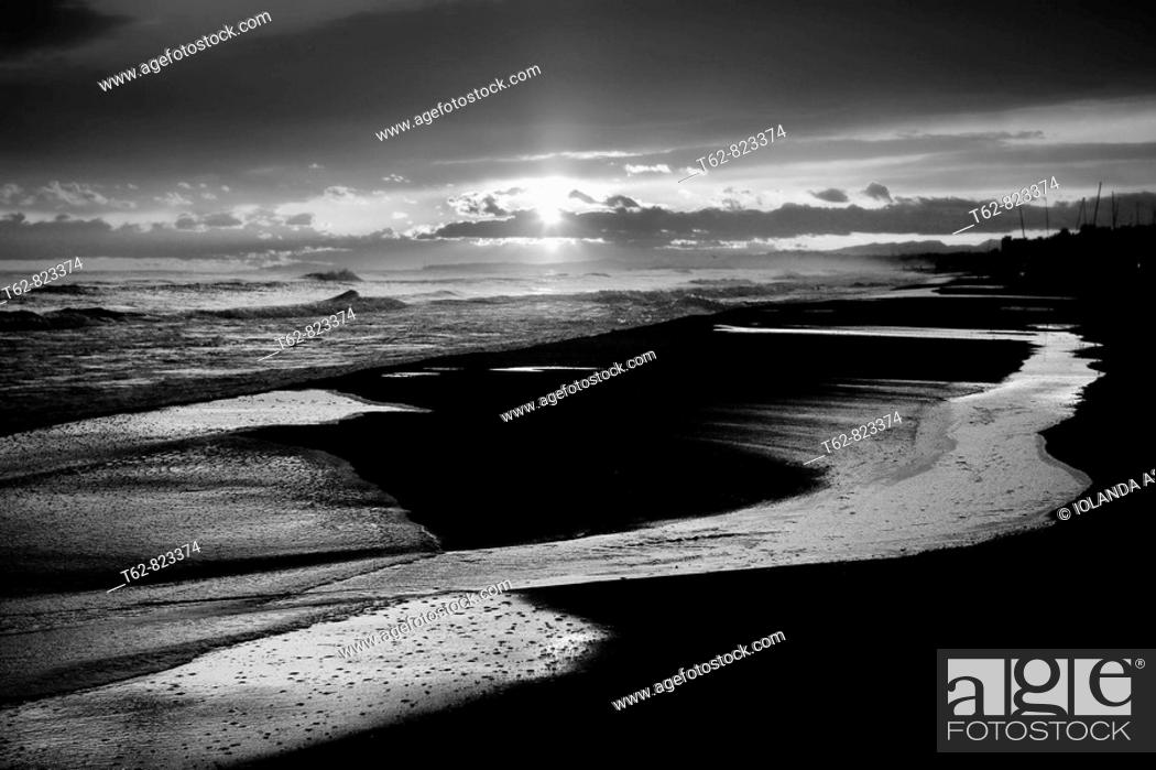 Stock Photo: Beach in calm after the storm Water in the sand.