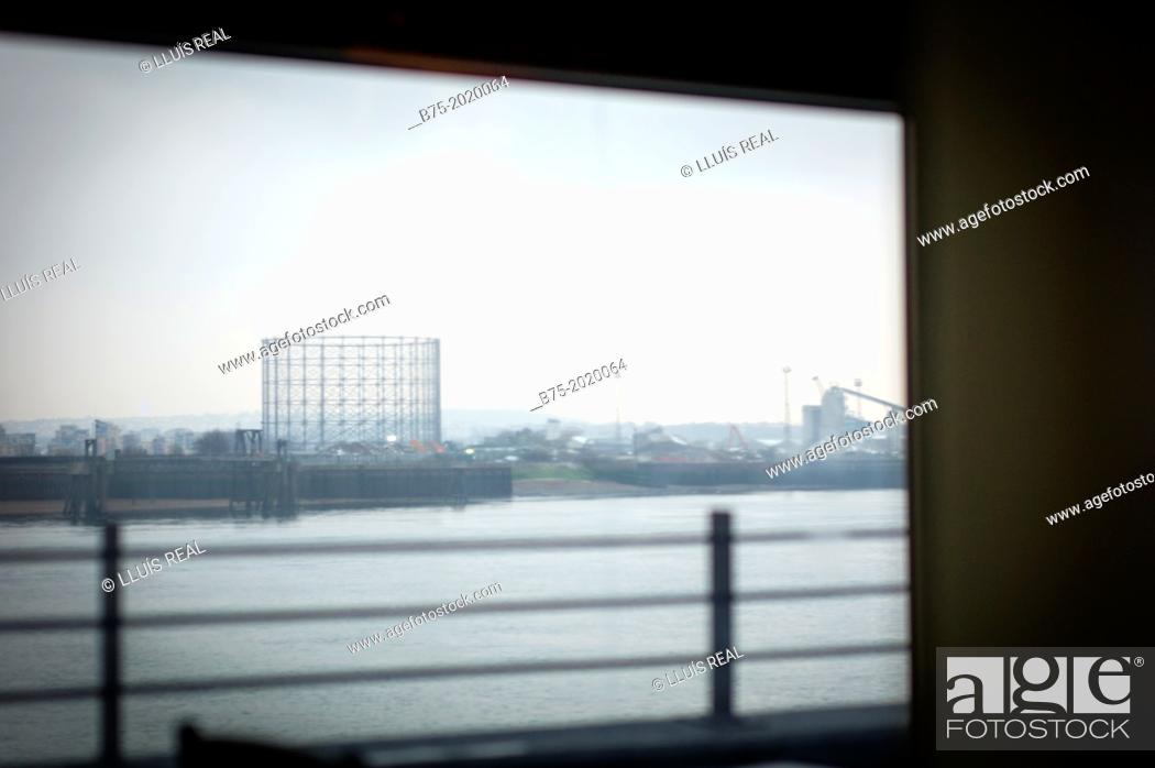 Stock Photo: View from Thames River of the industrial zone in the North Docks Greenwich, Greenwich Peninsula, London.