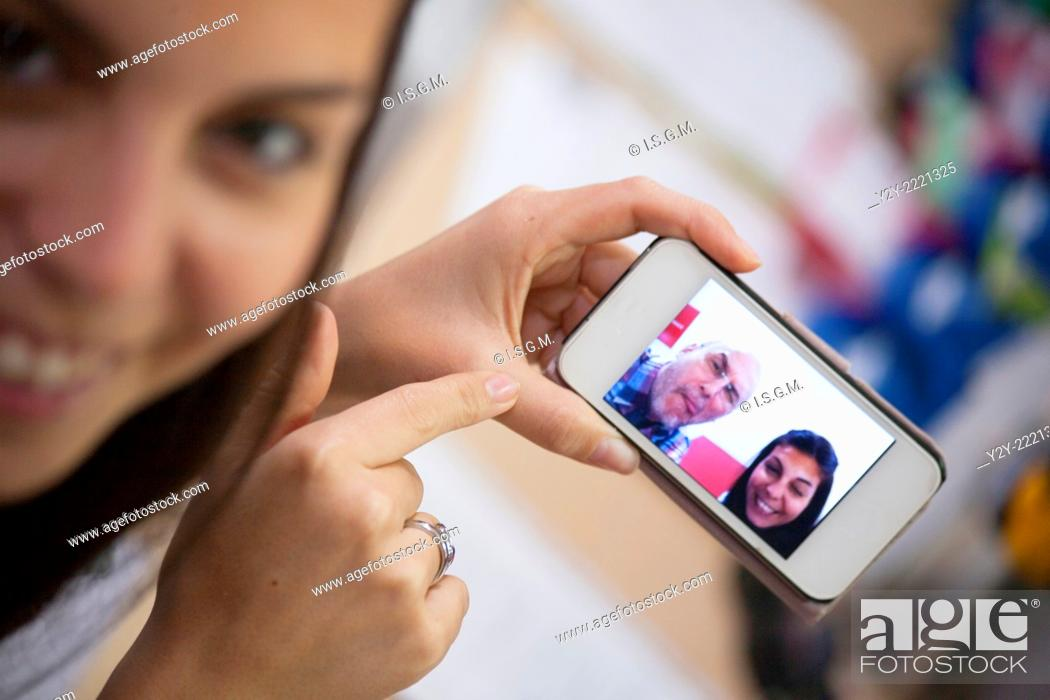 "Stock Photo: Girl with phone and """"Selfie""""."