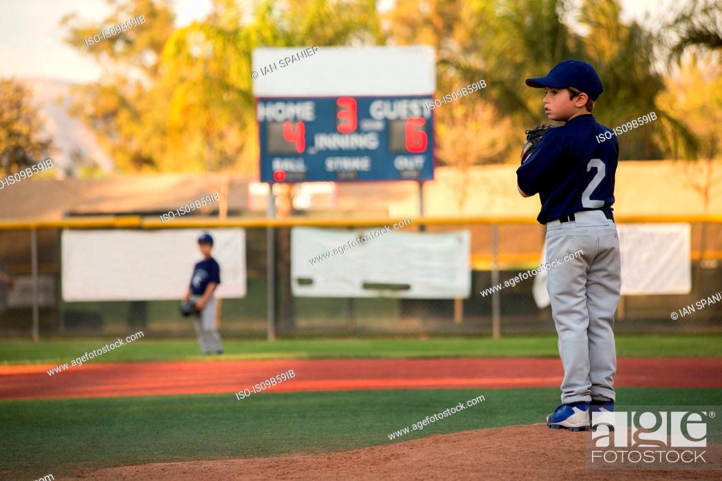 Photo de stock: Boy baseball pitcher preparing to throw on baseball field.