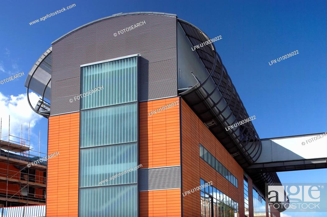 Stock Photo: Modern architecture of an office block cladded with terracotta.