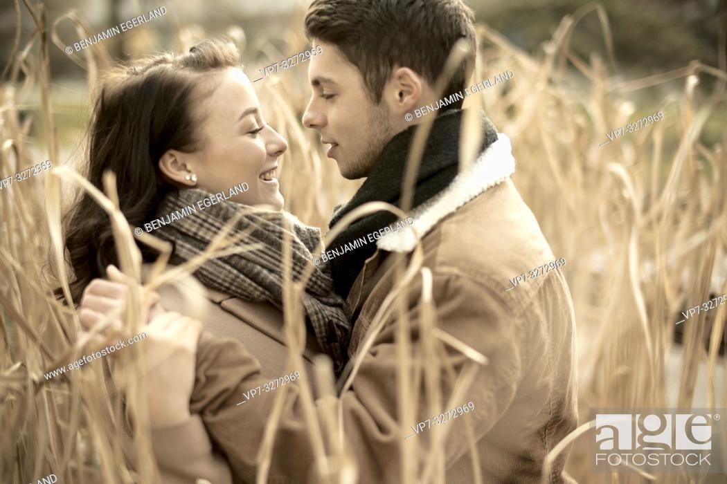 Stock Photo: young romantic teenage couple in reed, outdoors in nature, in Cottbus, Brandenburg, Germany.