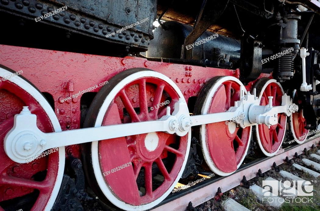 Stock Photo: old steam locomotive wheel and rods.