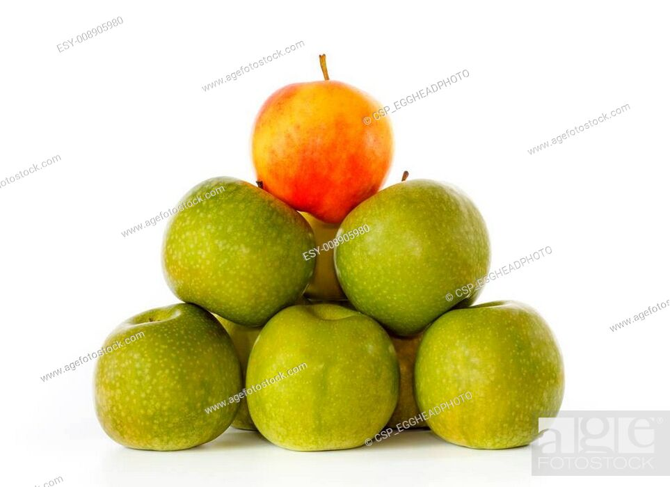 Imagen: Stack of green apples and one yellow with red blush on top.