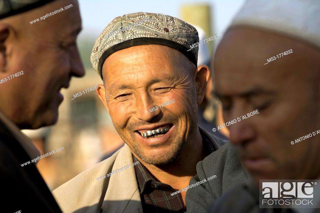 Stock Photo: A yughur man smile at the livestock market  kashgar  xinjiang  china.
