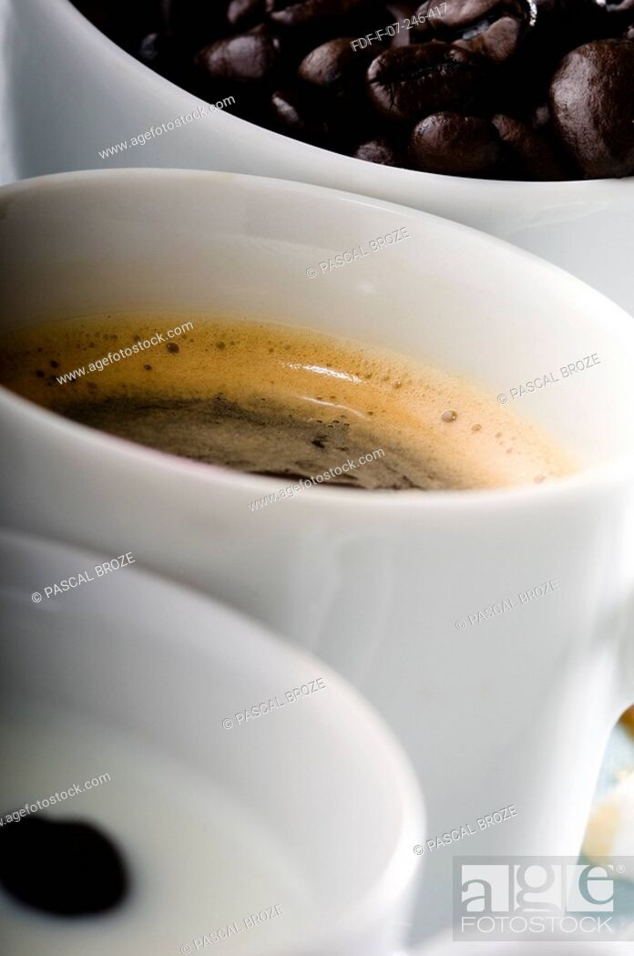 Stock Photo: Close-up of coffee cups with coffee beans.