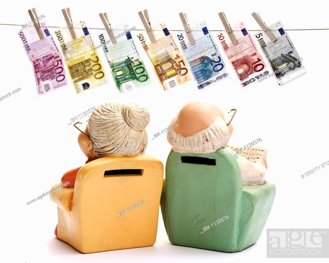 Stock Photo: Miniature figures of pensioners, grandma and grandpa in an armchair, looking at euro banknotes hanging from a clothesline.