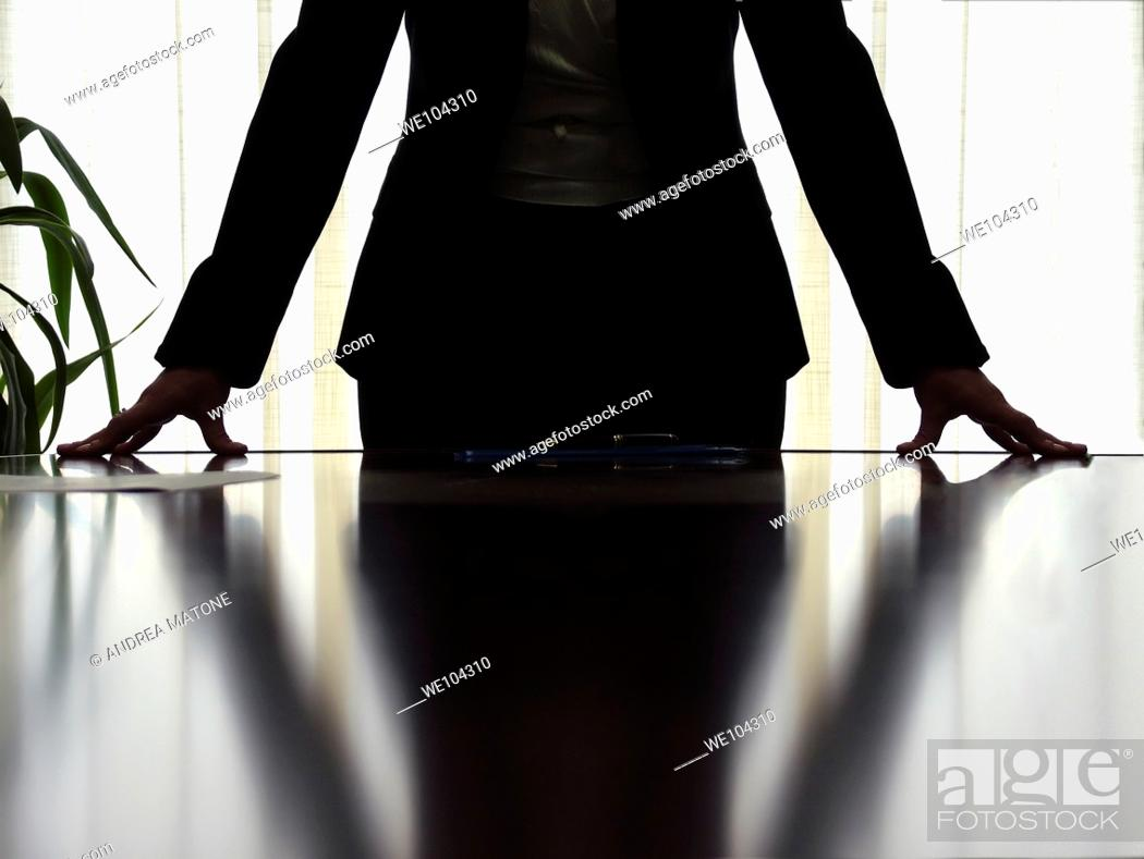 Stock Photo: Woman manager in a business stance during a meeting.