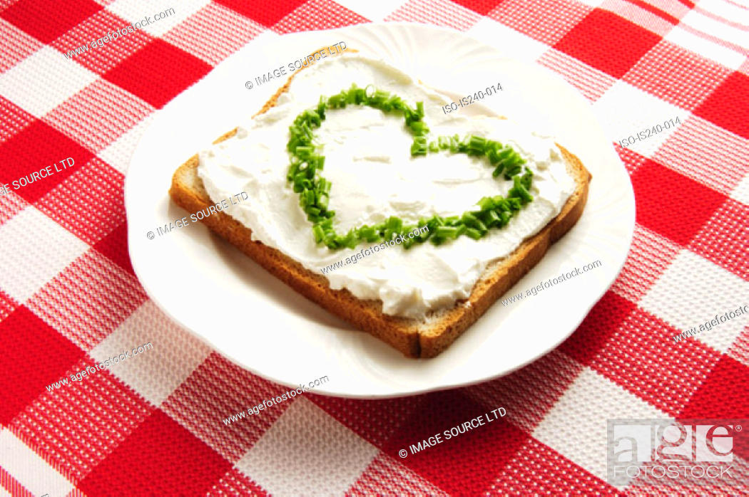 Stock Photo: Chives in heart shape on sandwich.
