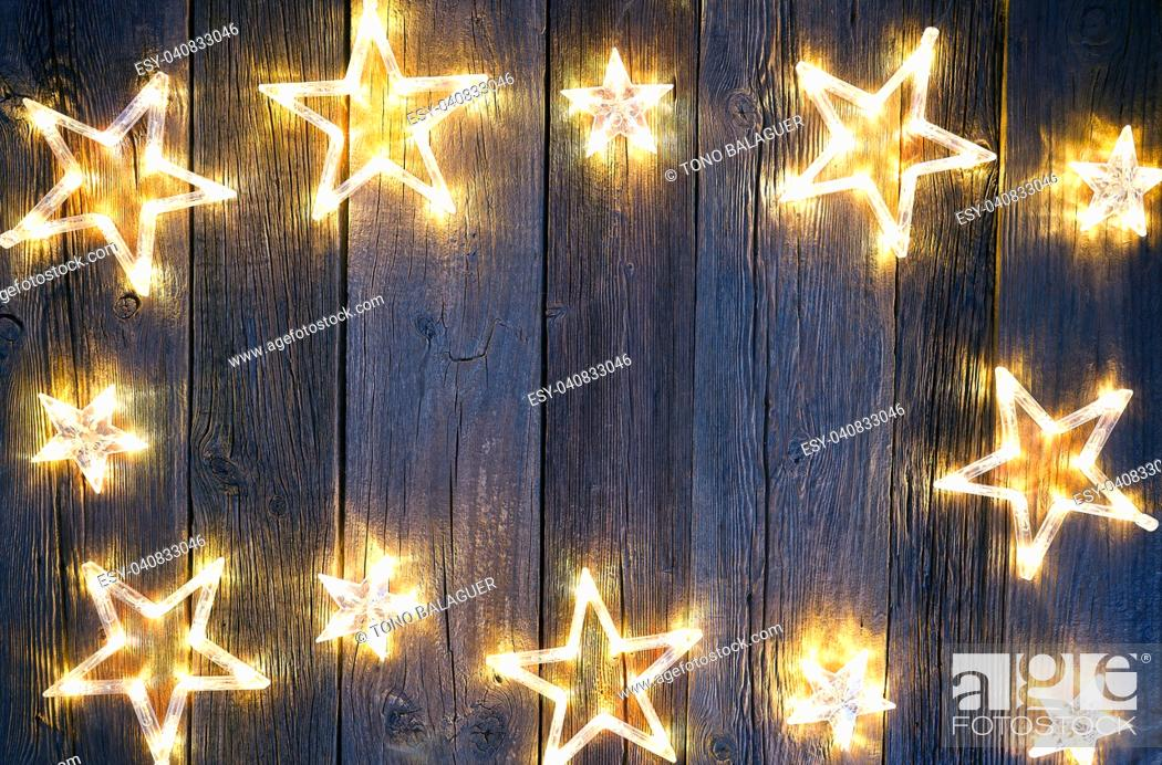 Stock Photo: Christmas background postcard vintage stars on wooden background.