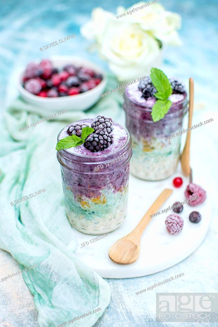 Stock Photo: Porridge with frozen blackberries, mint and spirulina.