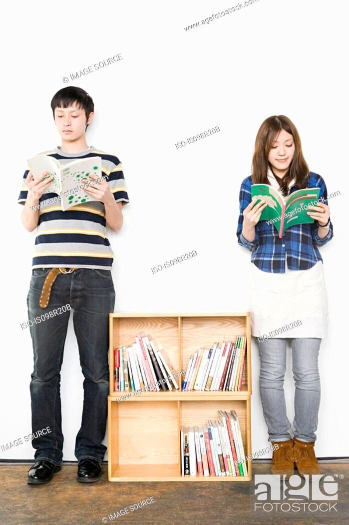 Stock Photo: Young man and woman reading books.