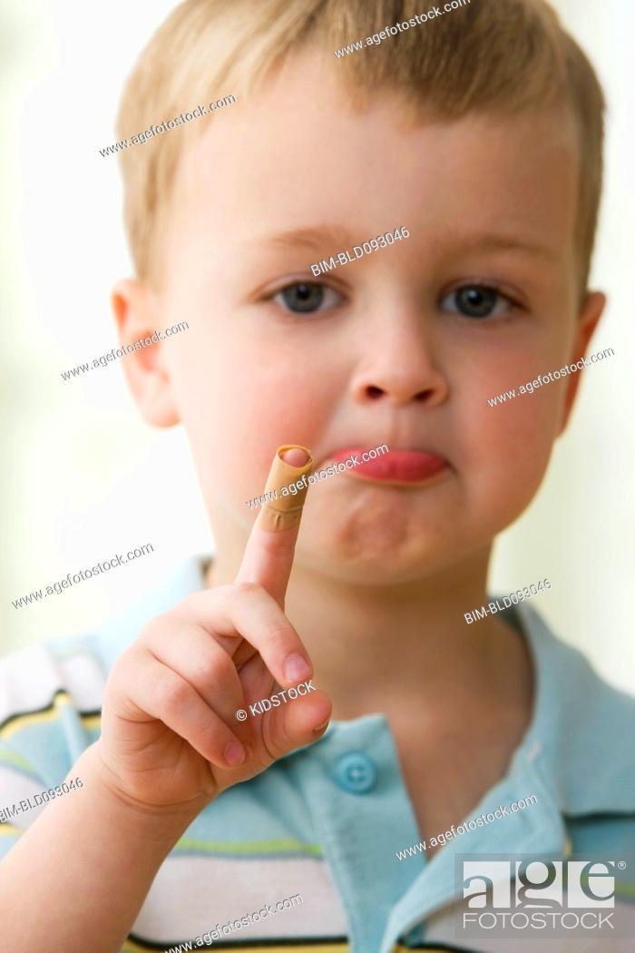 Stock Photo: Caucasian boy with bandage on finger.