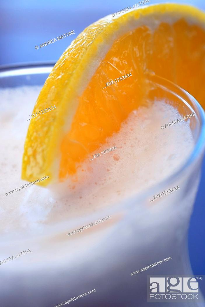 Stock Photo: A close up of an exotic tropical fruit drink in glass.
