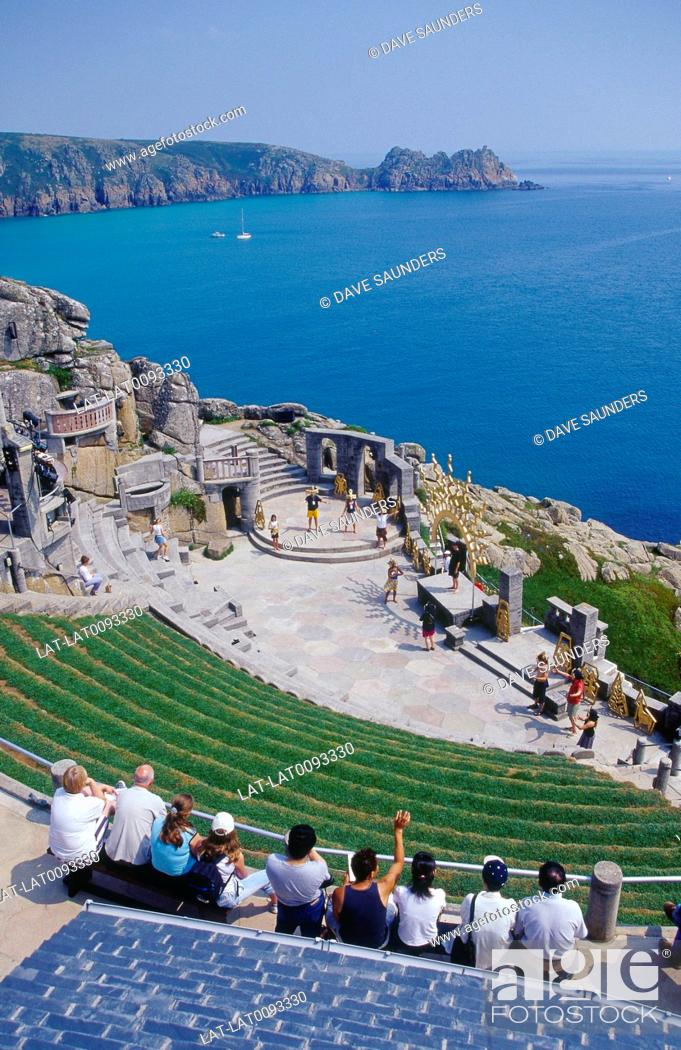 Stock Photo: Coast. Minack Theatre site carved into cliff. Stage. Seating. People and actors. Play.