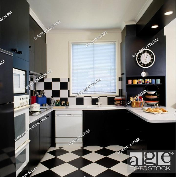 Black White Chequerboard Floor And Wall Tiles In Modern Black White Kitchen Stock Photo Picture And Rights Managed Image Pic Foh U12437383 Agefotostock