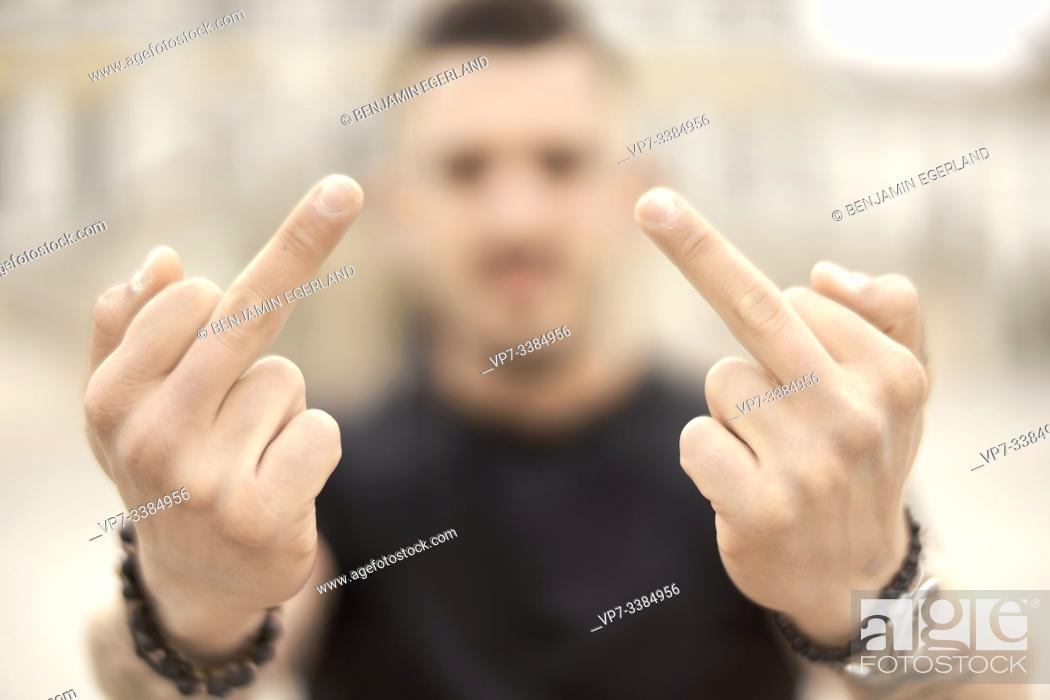 Stock Photo: Man giving the middle finger, in Munich, Germany.