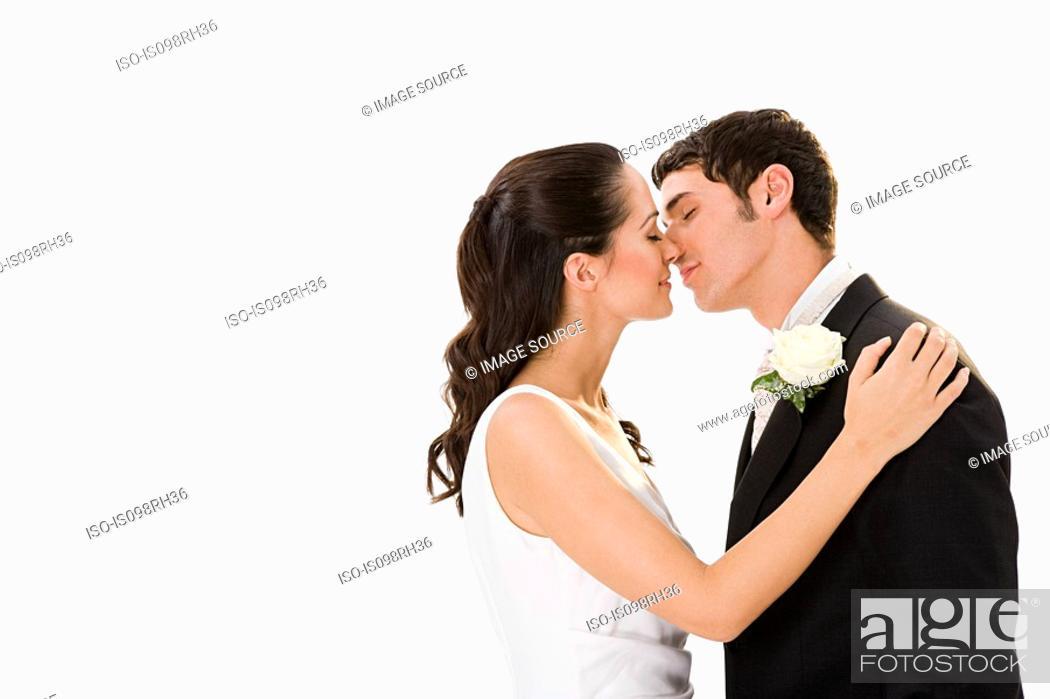 Stock Photo: Newlywed couple kissing.
