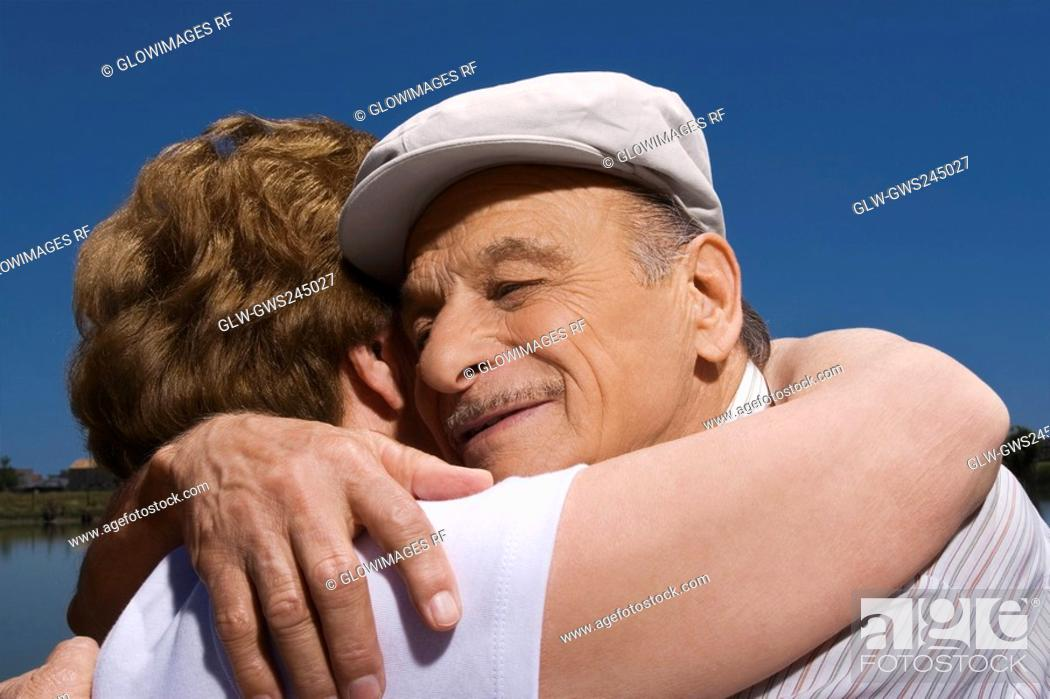 Stock Photo: Close-up of a senior couple embracing each other.