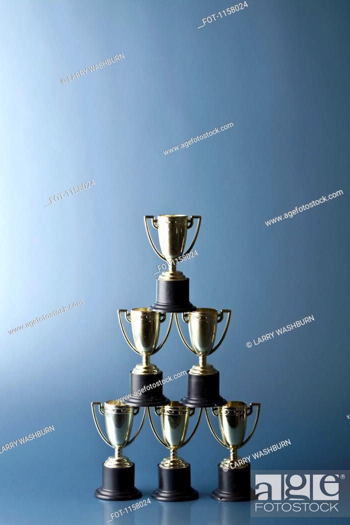 Stock Photo: Loving cup trophies stacked in a pyramid.