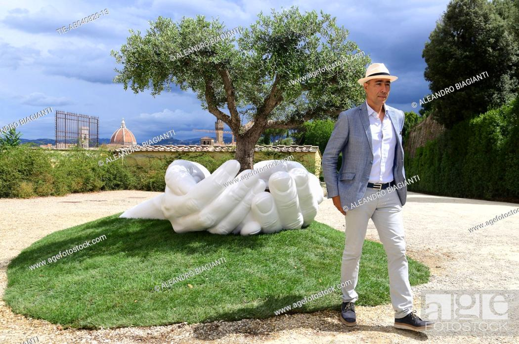 Stock Photo: The artist Lorenzo Quinn and his the artwork ' Give ' to the Boboli Gardens , Florence, ITALY-04-08-2020.