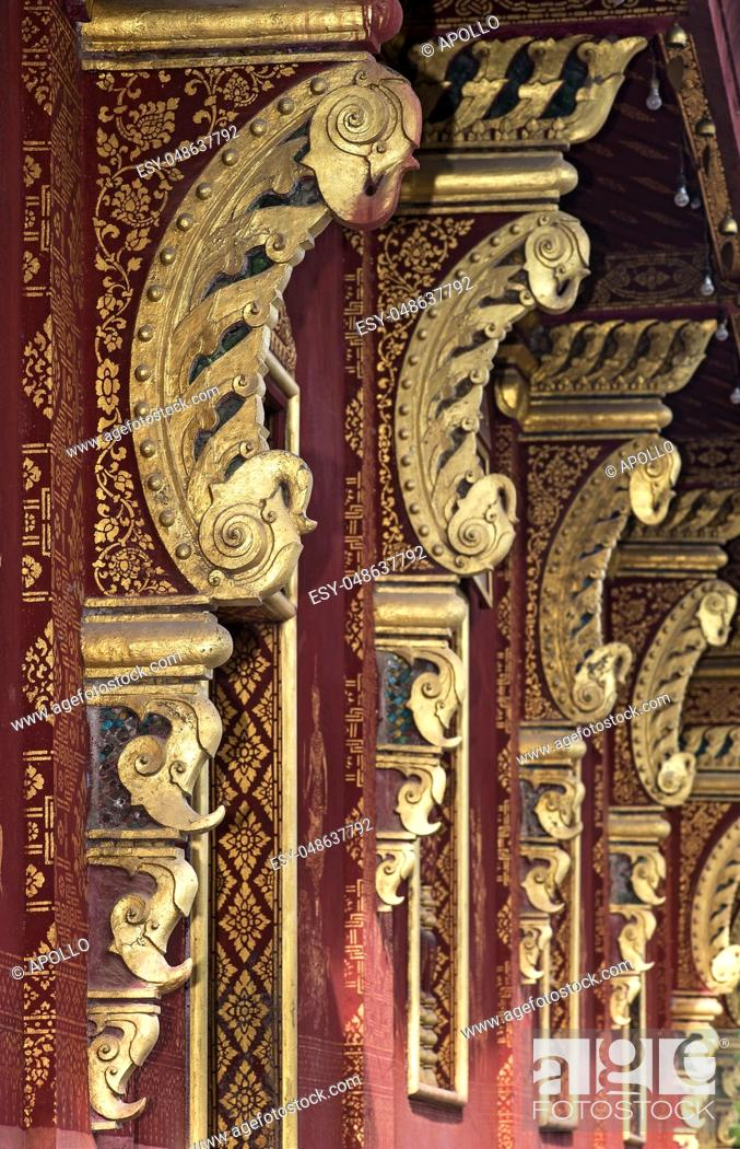 Stock Photo: Line of eave brackets at the outside wall of the temple Wat Sensoukharam, Luang Prabang, Laos.