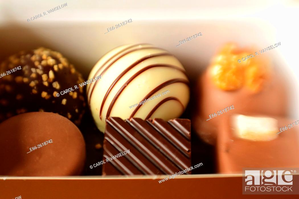 Stock Photo: Box of praline-filled chocolates. Shot with LensBaby for selective focus.