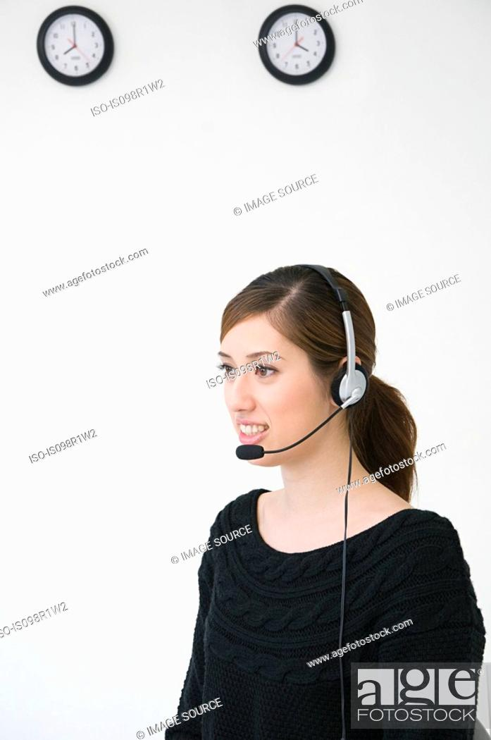 Stock Photo: A woman wearing a telephone headset.