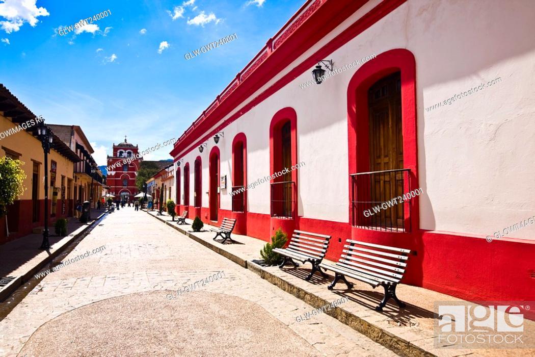 Stock Photo: Buildings on both sides of a street, San Cristobal De Las Casas, Chiapas, Mexico.