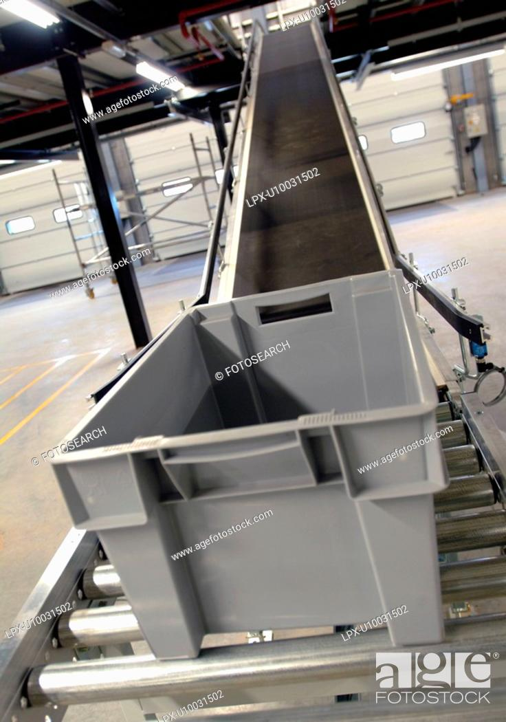 Stock Photo: Conveyor belt in warehouse distribution centre.