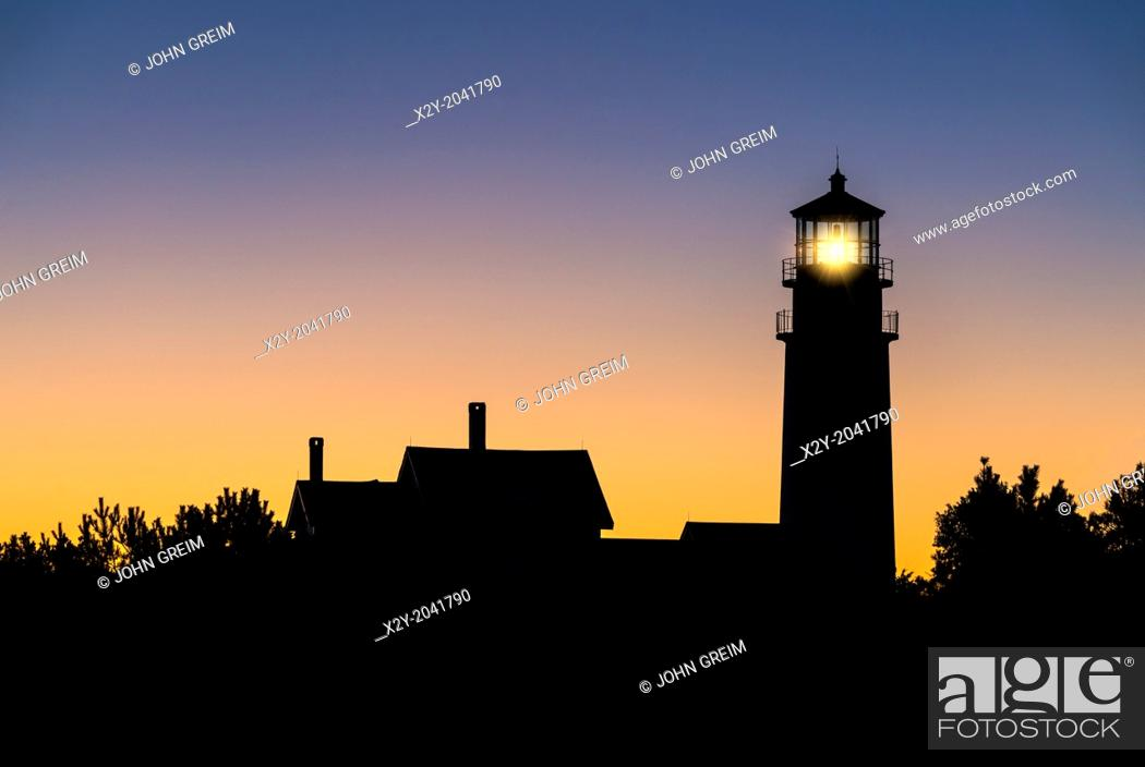 Stock Photo: Sillhouette of a lighthouse at dawn, Highland Light, Truro, Cape Cod, Massachusetts, USA.