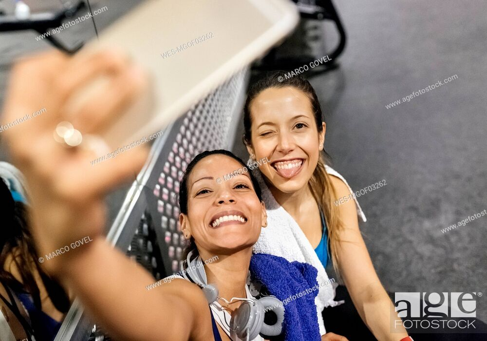Stock Photo: Two women making a selfie after work out in the gym.