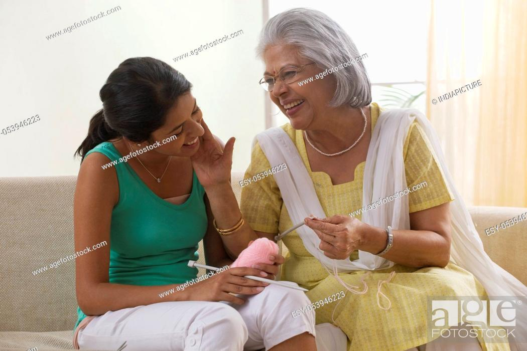 Stock Photo: Grandmother teaching granddaughter how to knit.