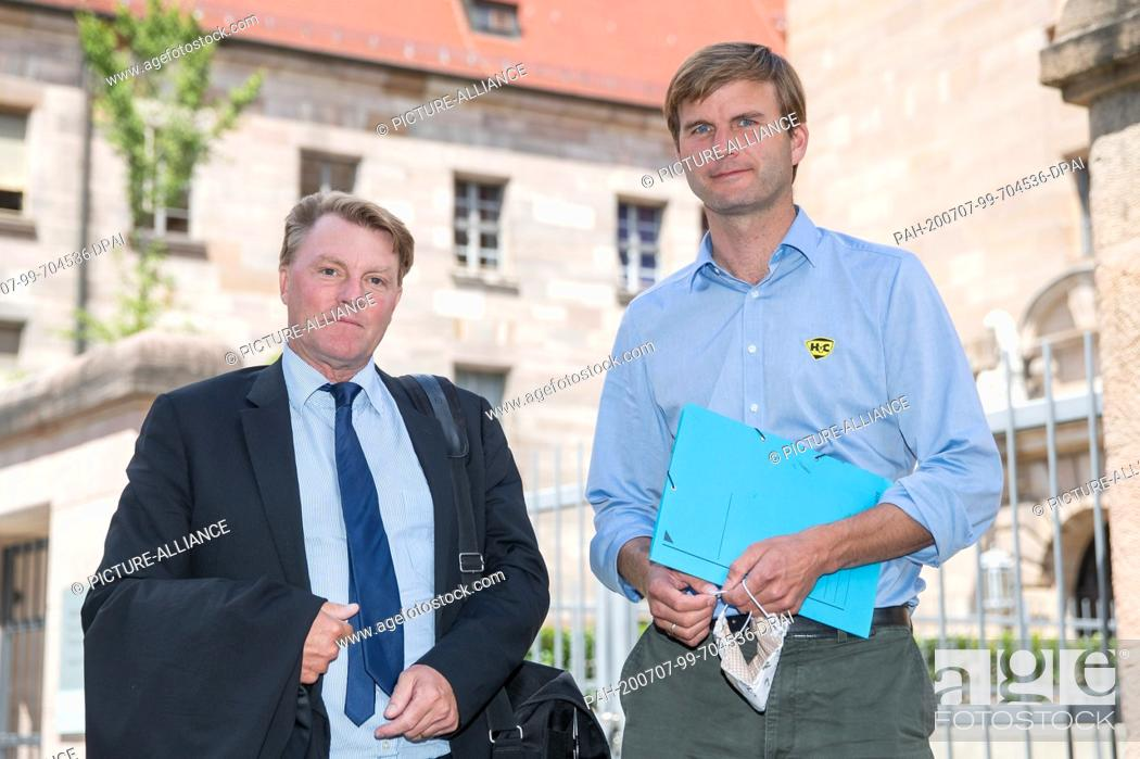 Stock Photo: 07 July 2020, Bavaria, Nuremberg: Hubertus Freiherr von Crailsheim (r) stands with his lawyer Ralf Bornhorst in front of the building of the Nuremberg-Fürth.