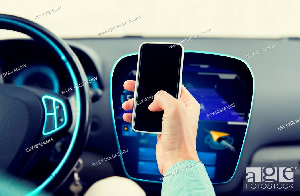 Stock Photo: transport, business trip, technology and people concept - close up of male hand with smartphone and navigator on board computer driving car.