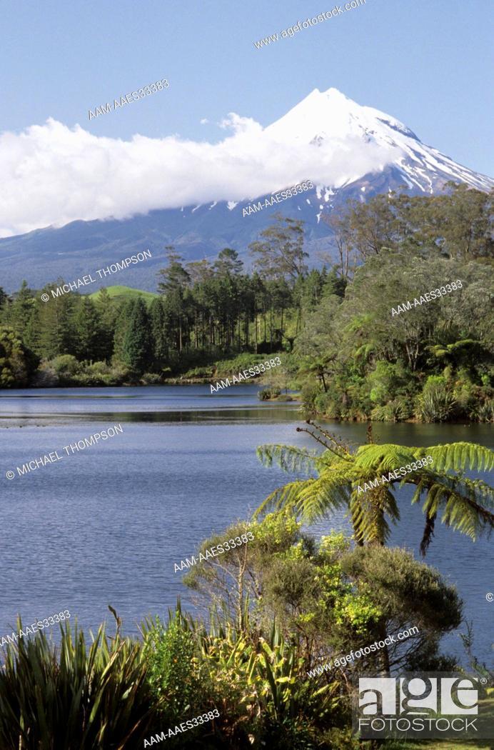 Stock Photo: Mt. Egmont (Mt. Taranaki) NZ rises above Lake Mangamahoe near New Plymouth on No.Is.