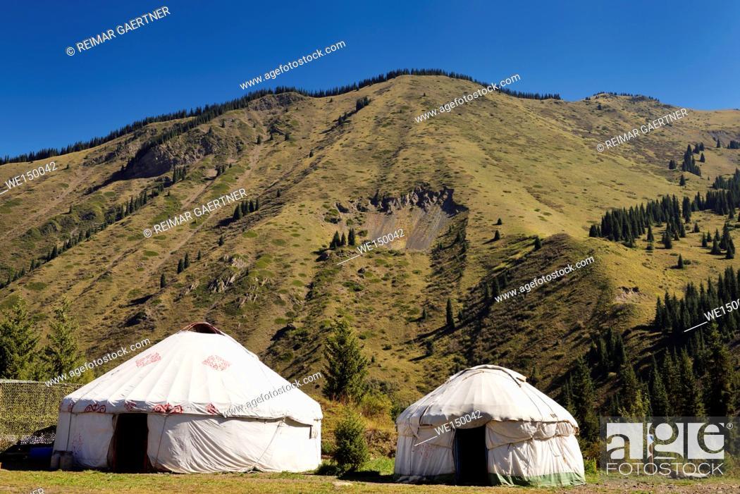 Stock Photo: Yurts at a campground of Kaindy Lake in the Kungey Alatau mountain range Kazakhstan.