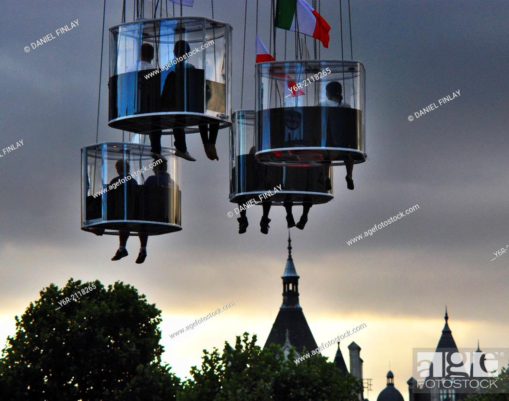 Stock Photo: Riders on the Starflyer, near the London Eye, on the banks of the Thames, in the heart of London, ascending to eighty meteres above the city.