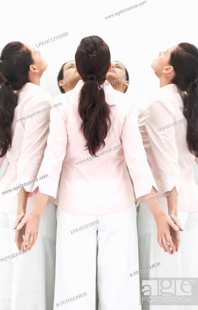 Stock Photo: Woman facing mirror, looking up.