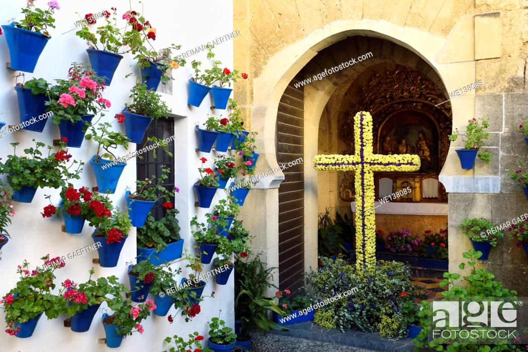 Stock Photo: Our lady of Bethlehem and Shepherds Chapel with flower pots in courtyard during Spring festival Cordoba.