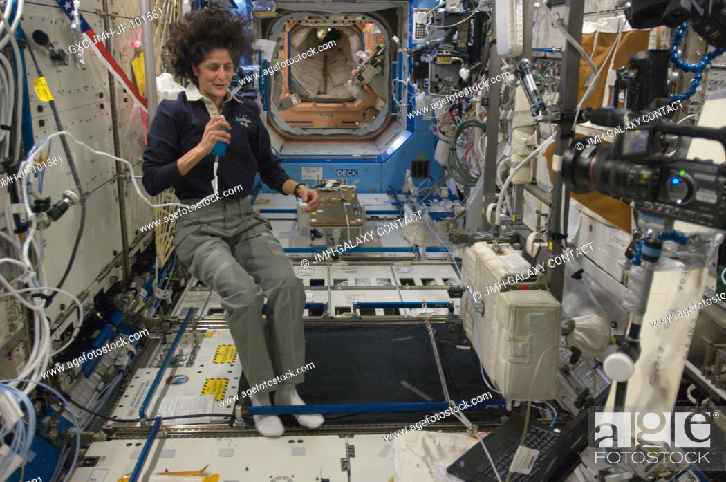 Stock Photo: NASA astronaut Sunita Williams, Expedition 33 commander, talks on a microphone in the Destiny laboratory of the International Space Station.