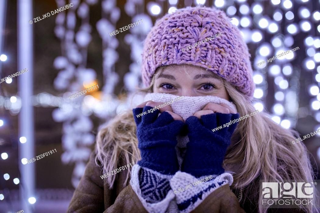 Stock Photo: Portrait of young woman in winter clothes freezing.