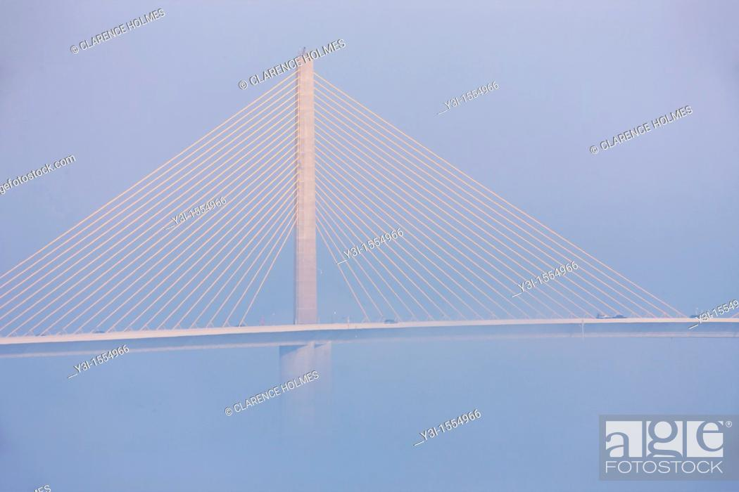 Stock Photo: The Bob Graham Sunshine Skyway Bridge, spanning Tampa Bay, partially hidden by fog as viewed from Fort Desoto Park, Tierra Verde, Florida, USA.